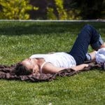 woman lying on the grass
