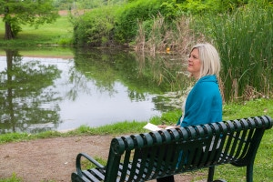 Carolyn on bench by water